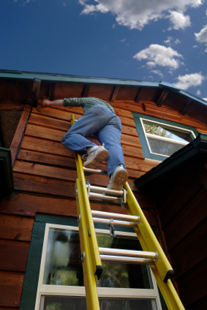 painting exterior on ladders